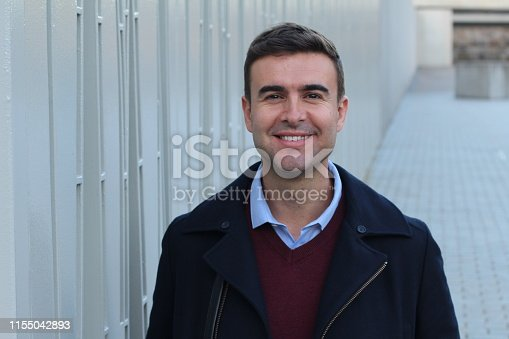 Handsome businessman smiling with copy space.
