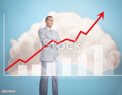 904389218istockphoto Handsome businessman standing behind graphics 504705441