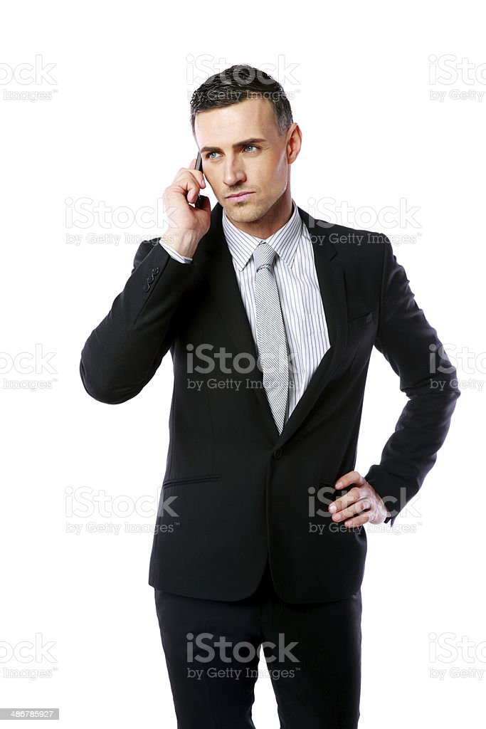 Handsome businessman talking on the phone stock photo