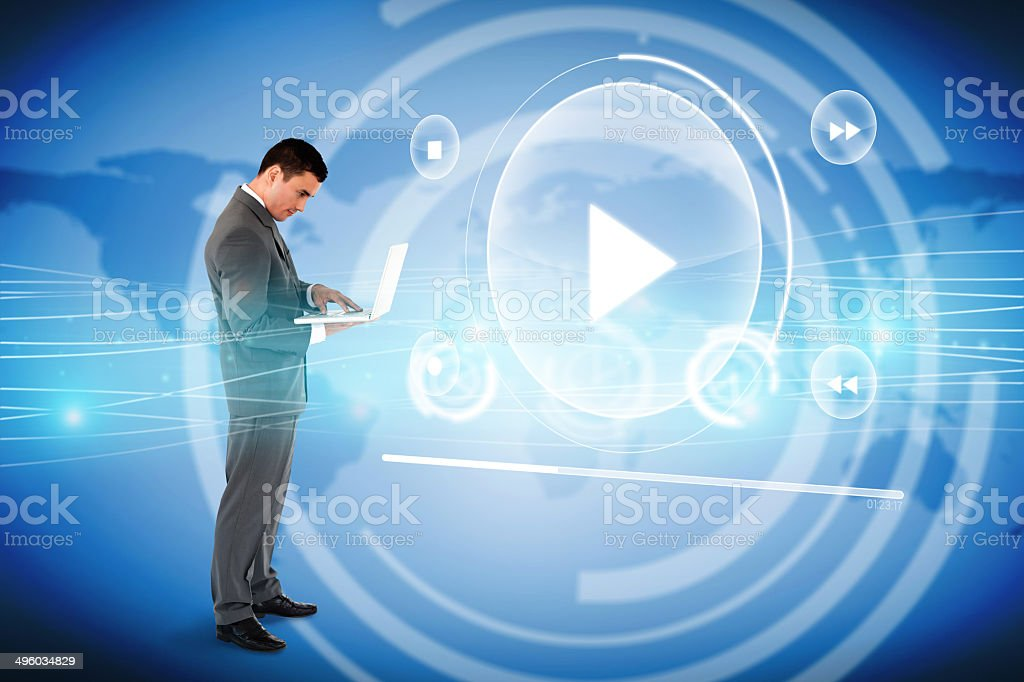 Handsome businessman using laptop with music player interface royalty-free stock photo