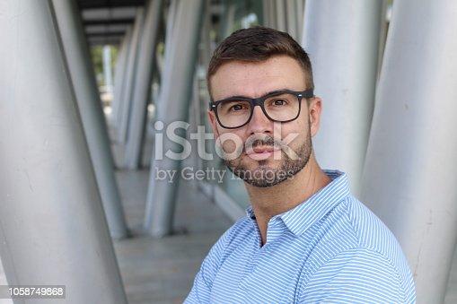 Handsome businessman wearing eyeglasses close up.