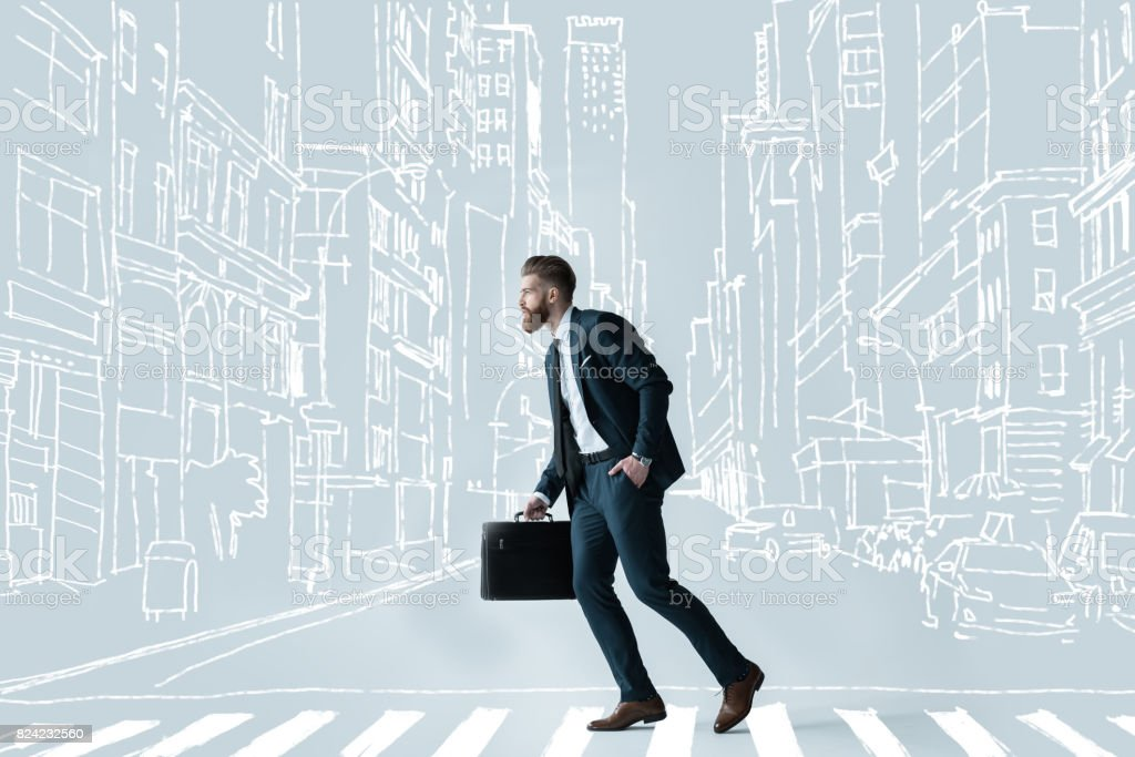 Handsome businessman with briefcase stock photo