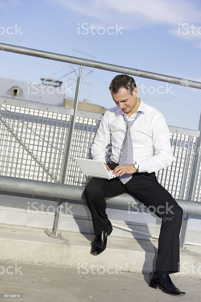 handsome businessman with laptop royalty-free stock photo