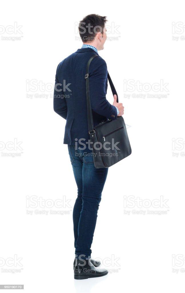 Empresário de bonito com telefone, papelada e bolsa de ombro - foto de acervo