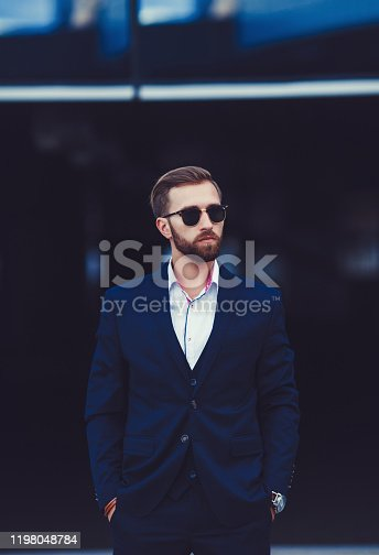 907934274 istock photo Handsome businessman with sunglasses 1198048784