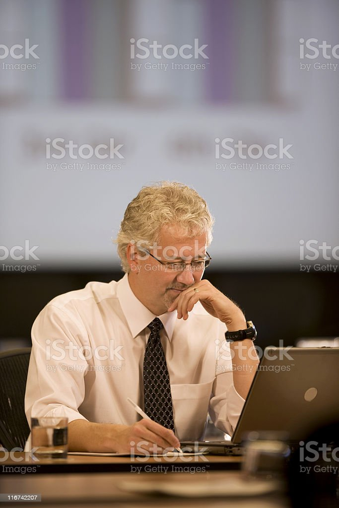Handsome Businessman Working At His Desk royalty-free stock photo