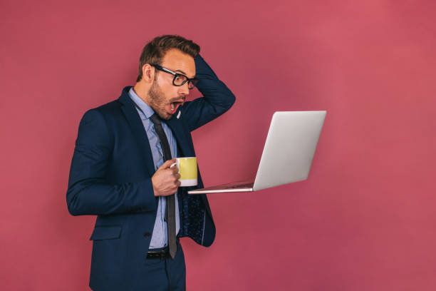 Handsome businessman working in a laptop stock photo