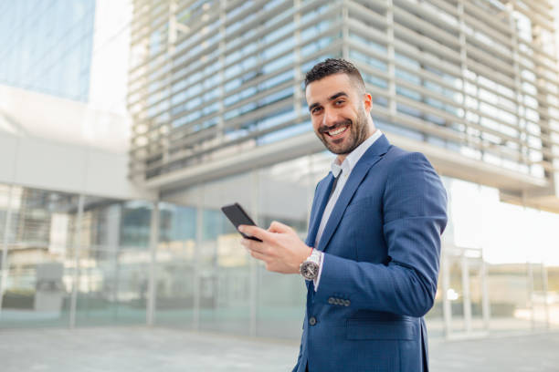 Handsome businessman working on the go stock photo