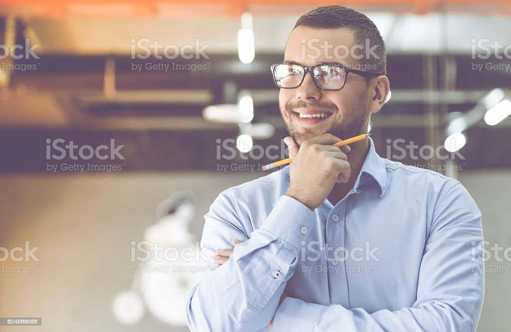 Handsome businessman working stock photo