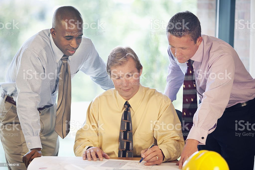 Handsome Businessmen Looking At Drawings royalty-free stock photo