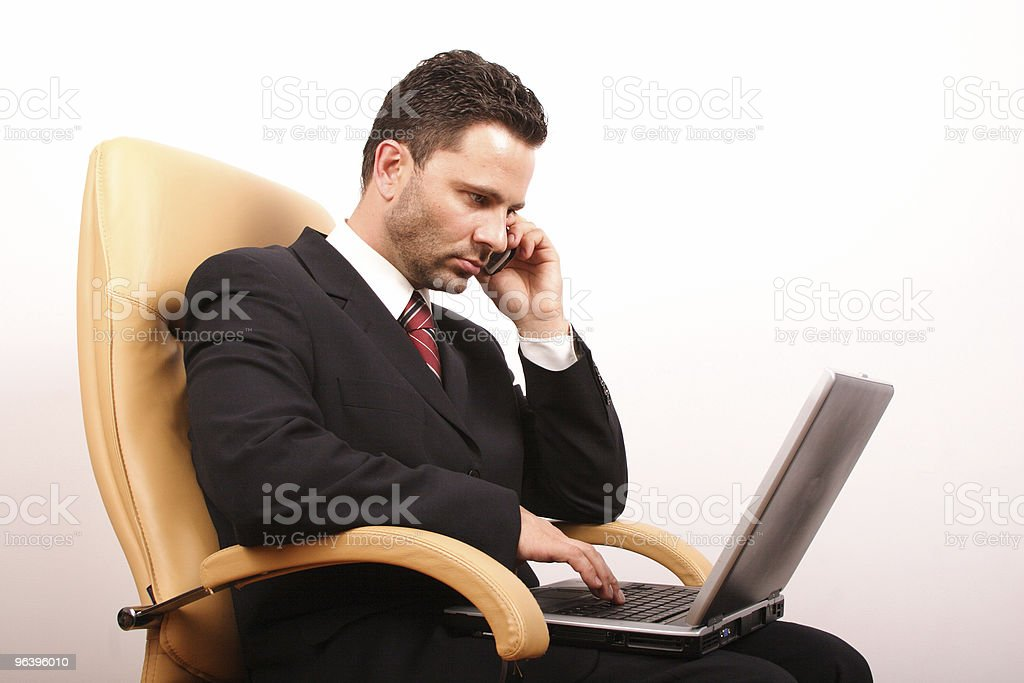 Handsome calling businessman with laptop 3 - Royalty-free Adult Stock Photo