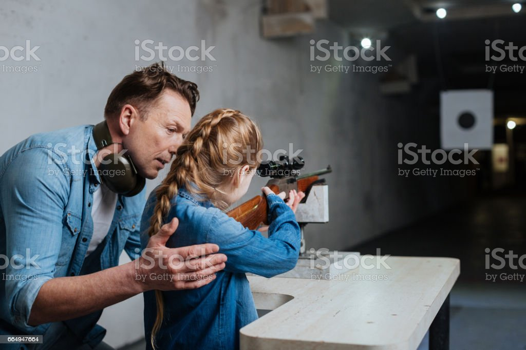 Handsome caring father teaching his daughter stock photo