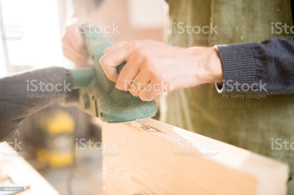 Handsome Carpenter Working in Sunlight royalty-free stock photo