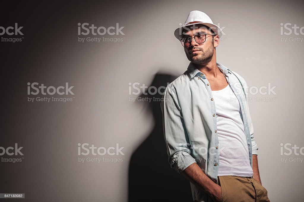 handsome casual man looking away from the camera stock photo