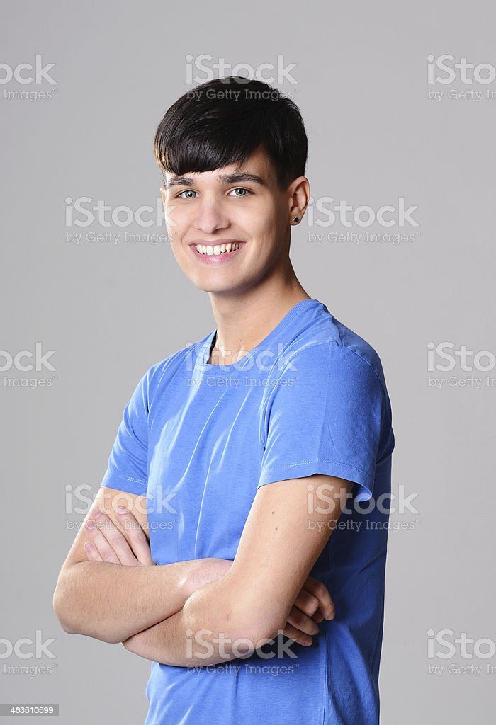 Handsome caucasian casual teenager with dark hair on isolated background stock photo
