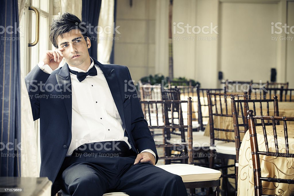 Handsome caucasian male in tuxedo after the party stock photo