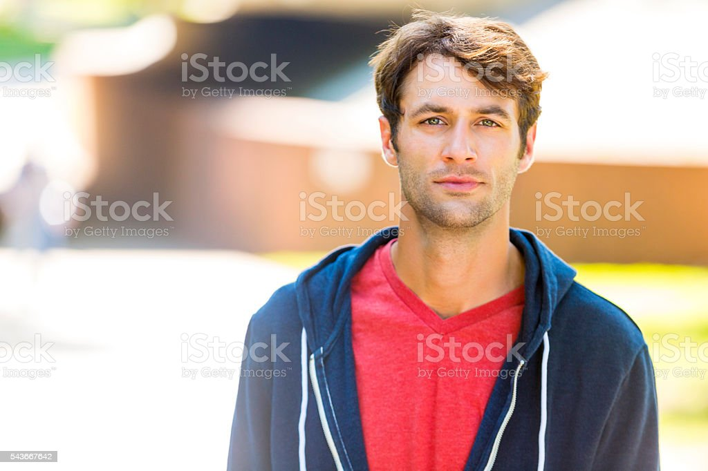 Handsome caucasian man with brown hair and scruff stock photo