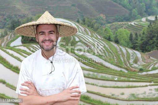 607590542istockphoto Handsome Caucasian tourist in Asian rice terraces 1158409801