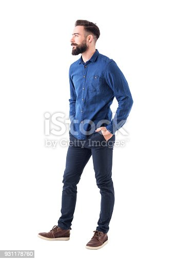 931173966istockphoto Handsome charming bearded business casual man with hands in pockets looking away and smile 931178760