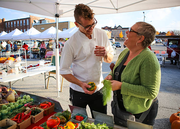 Handsome Chef and Cute Friend Shopping at Local Farmers Market stock photo