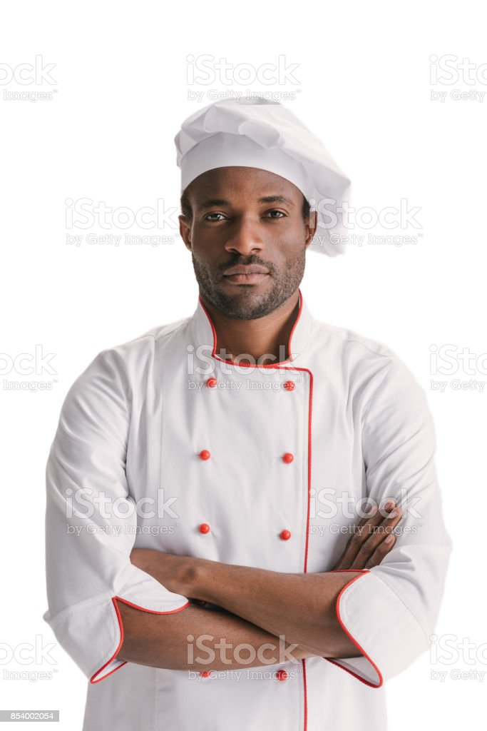 handsome chef with folded arms stock photo