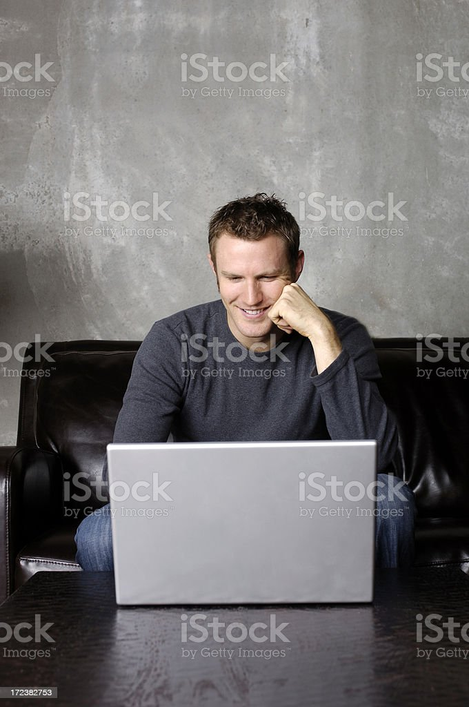 Handsome college student working on laptop royalty-free stock photo