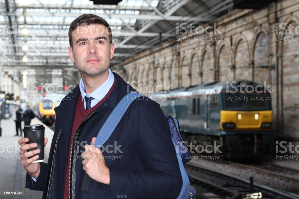 Handsome commuter at railway station - Royalty-free Adult Stock Photo