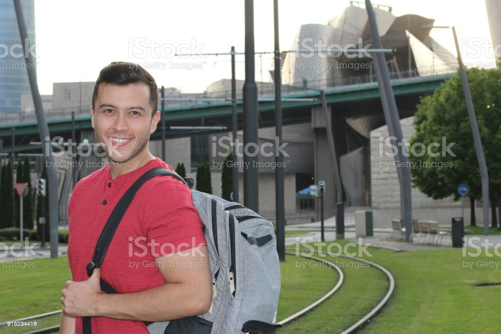Handsome commuter smiling while waiting for train - Royalty-free 20-29 Years Stock Photo