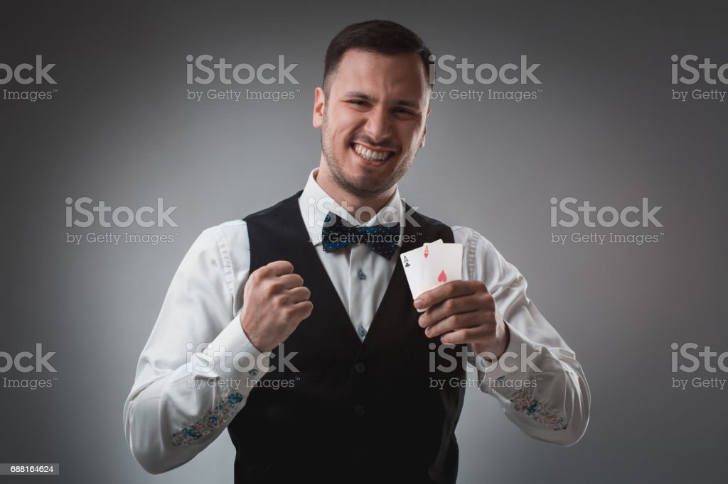 Handsome confident man holding cards looking at camera stock photo