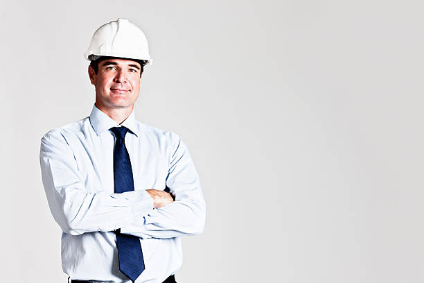 handsome construction boss engineer or architect smiles at camera - civil engineer stock photos and pictures