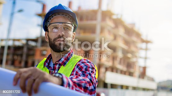 istock Handsome construction worker at construction site 800351720
