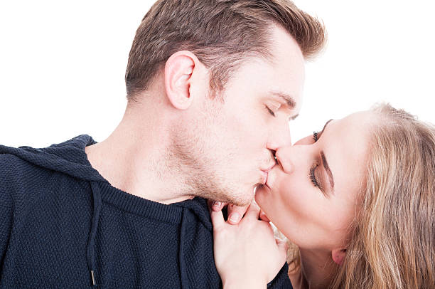 Handsome couple kissing and being affective close-up Handsome couple kissing and being affective close-up wearing casual autumn clothes isolated on white background affective stock pictures, royalty-free photos & images