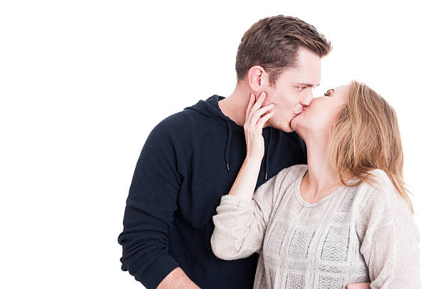 Handsome couple kissing and being affective Handsome couple kissing and being affective wearing casual autumn clothes isolated on white background with copy text space affective stock pictures, royalty-free photos & images