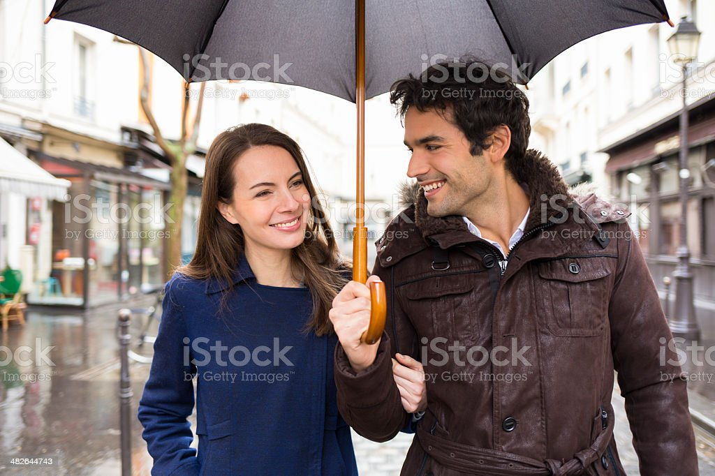 Handsome couple under the rain on street royalty-free stock photo