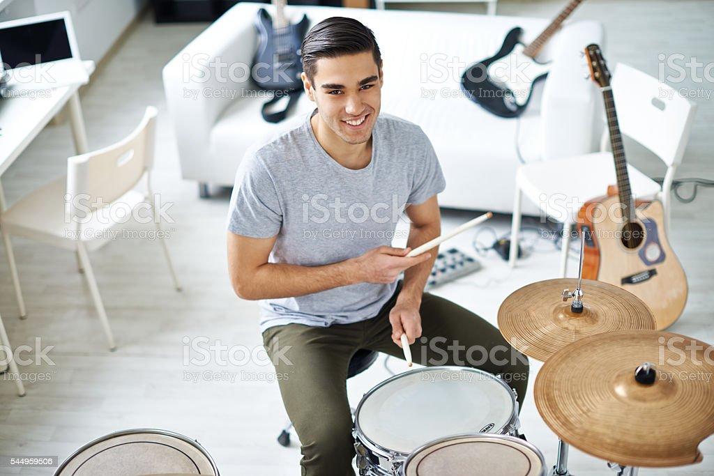 Handsome drummer stock photo