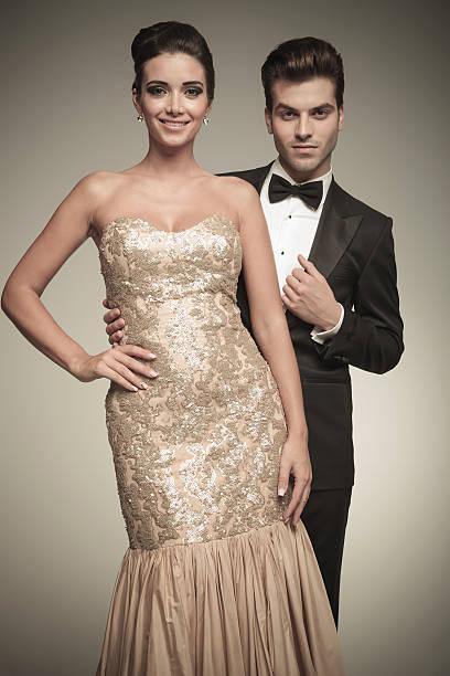 handsome elegant man standing behind his wife - knotenkleid stock-fotos und bilder
