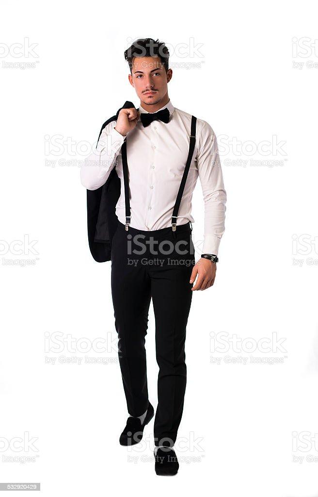 9b4121e08b1e4 Élégante jeune bel homme avec costume et noeud papillon photo libre de  droits