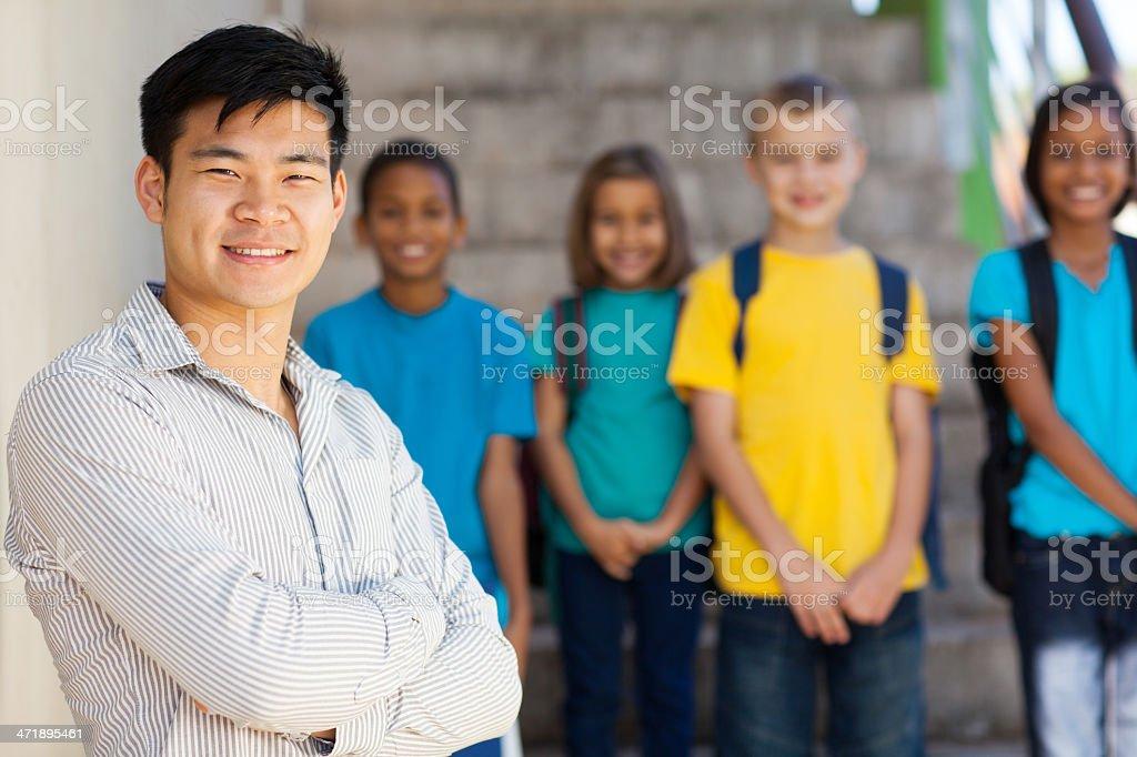 handsome elementary school educator stock photo