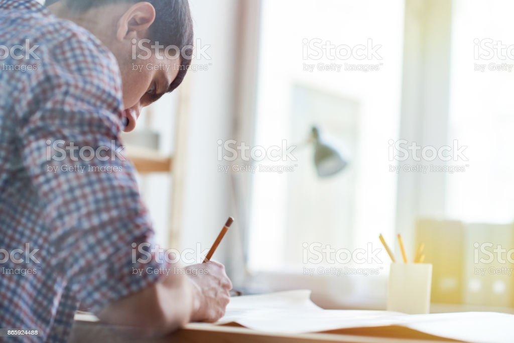 Handsome engineer working on important project stock photo