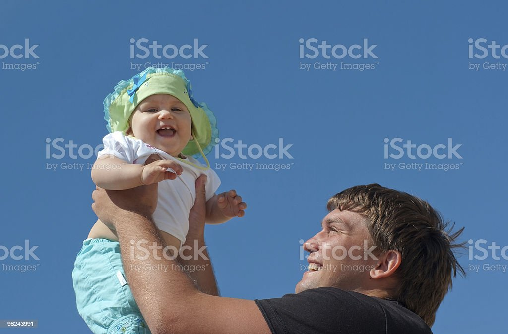 Handsome father holding his cute daughter royalty-free stock photo