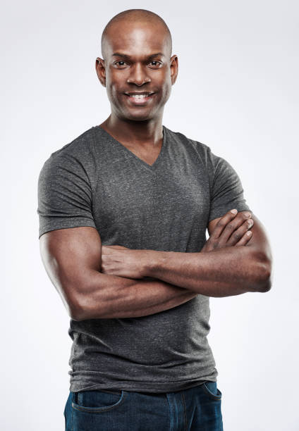 Handsome fit smiling man with folded arms stock photo