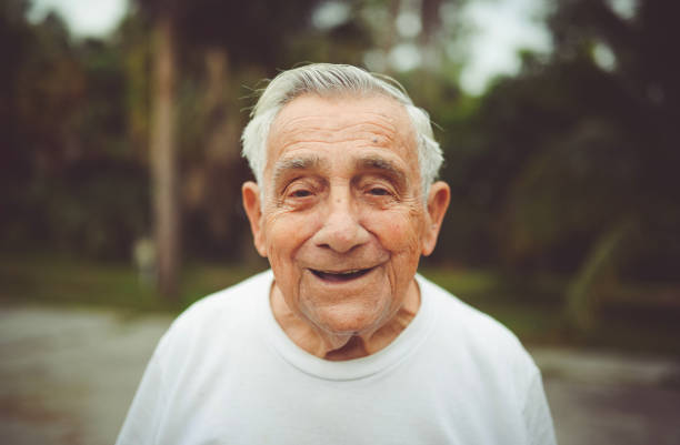 Handsome funny elderly man in a portrait stock photo