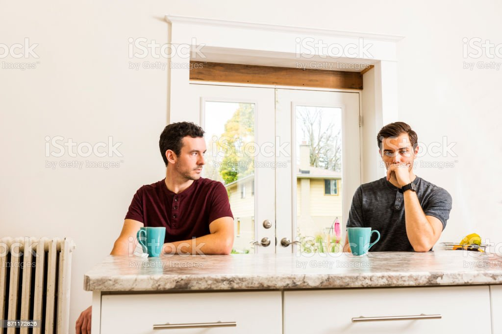 A handsome gay couple experiencing relationship issues. stock photo