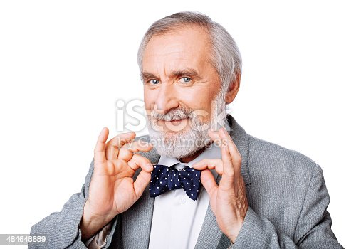 973213156 istock photo Handsome gentleman with a bow tie 484648689