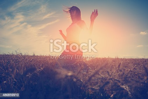 Young and handsome girl dancing outdoors at sunset