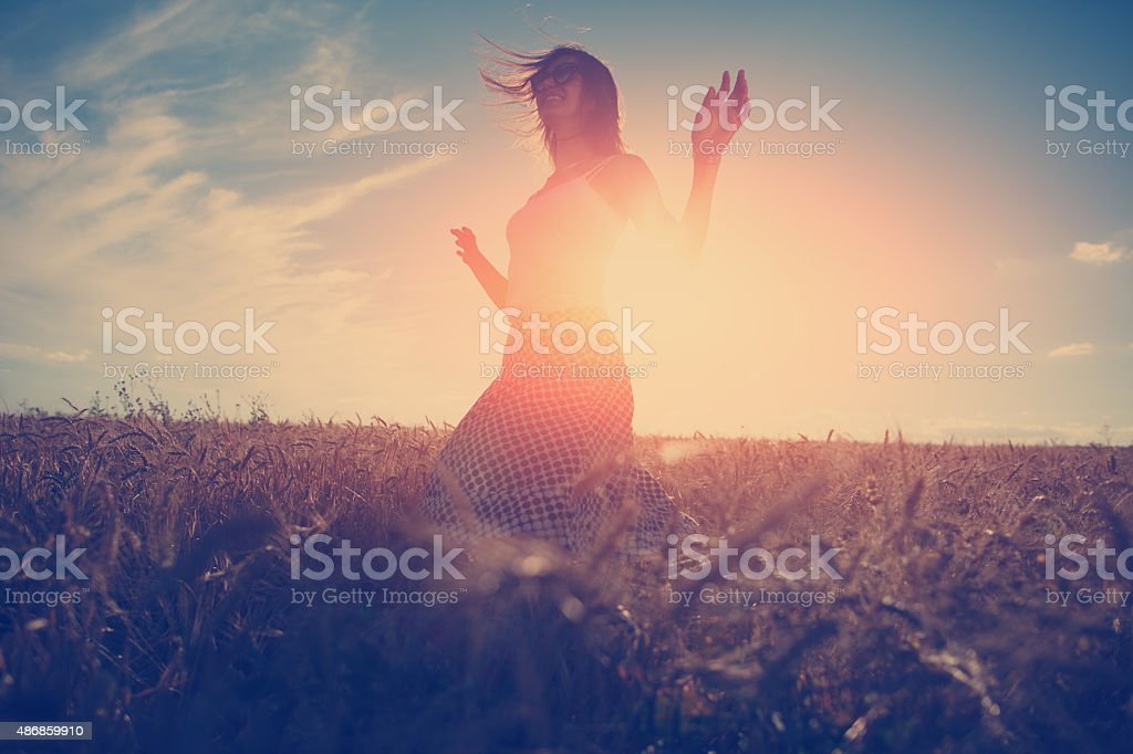 Handsome girl dancing at sunset stock photo