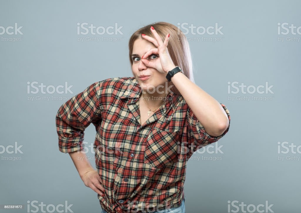 Handsome girl with hand gesture stock photo