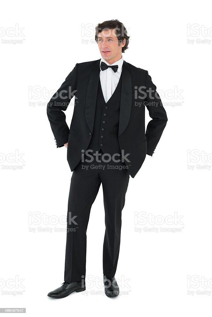 Handsome groom looking away stock photo