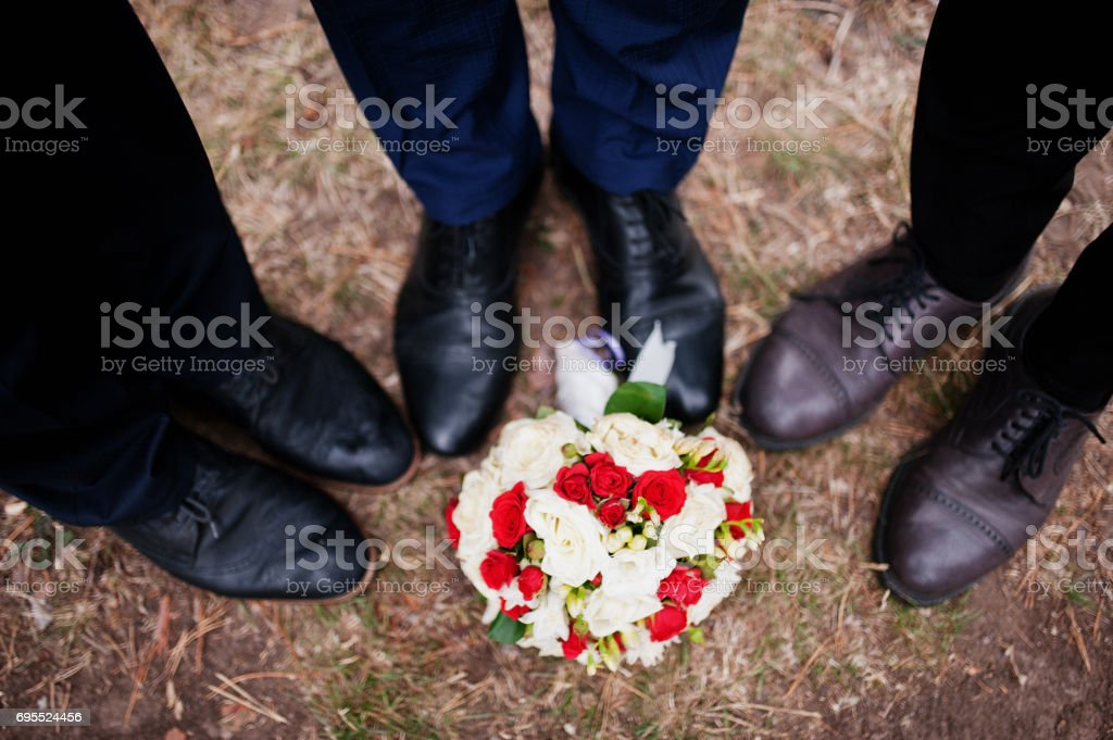 Handsome groom with cool groomsmen walking in the forest and having fun on a wedding day. stock photo