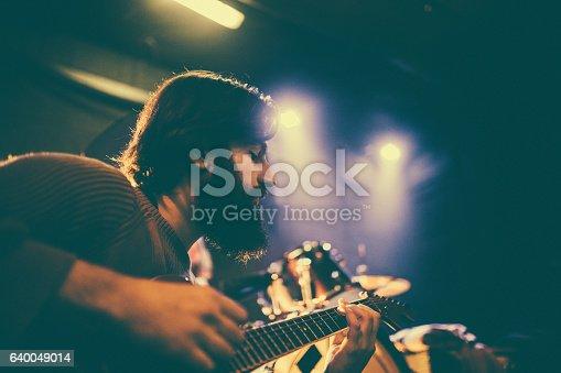 849313464istockphoto Handsome guitar player 640049014